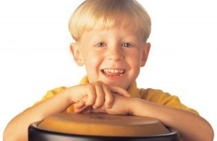 Photo-Kindermusik-BigKid-boy-drum-smiling-3316x2157- 3316x2157